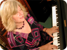 Cathy DeWitt playing a piano