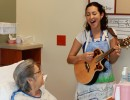 Danielle singing to a patient