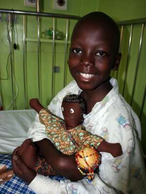 AIM for Africa patient with doll