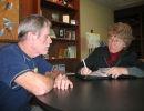 Barbara Esrig writes an oral history while interviewing Thomas Mitchell.